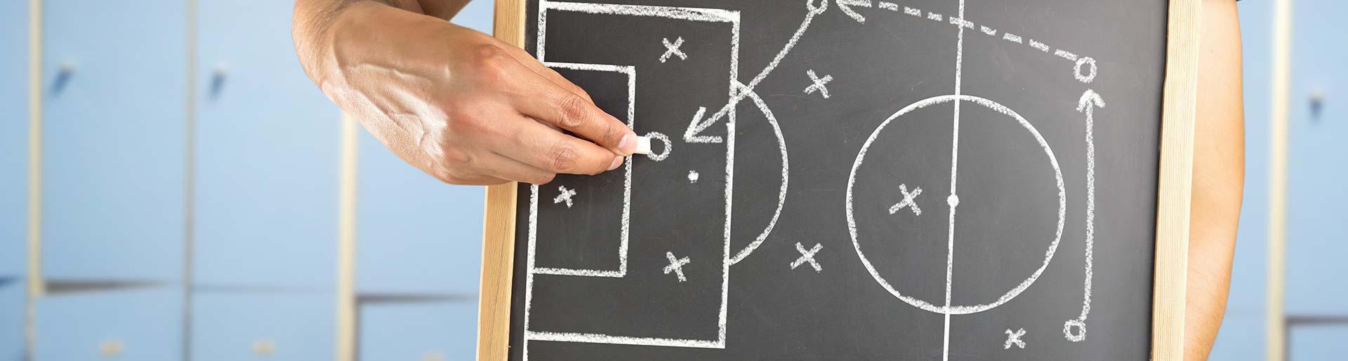 Fußballtrainer - taktisches Geschick und soziale Kompetenz